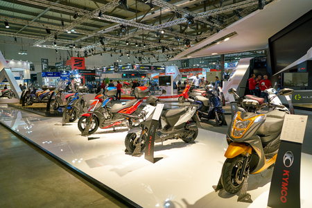 MILAN, ITALY - NOVEMBER 11, 2017: scooters on display at EICMA 2017 - 75th International Motorcycle Exhibition.
