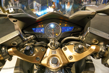 MILAN, ITALY - NOVEMBER 11, 2017: close up shot of the control panel on a motorcycle at the EICMA 2017 - 75th International Motorcycle Exhibition