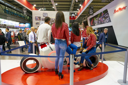 MILAN, ITALY - NOVEMBER 11, 2017: the models poses during the EICMA 2017 - 75th International Motorcycle Exhibition.