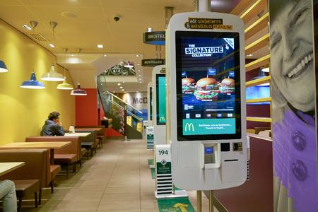 DUSSELDORF, GERMANY - CIRCA SEPTEMBER, 2018: self ordering kiosks at McDonald's restaurant.
