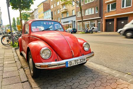DUSSELDORF, GERMANY - CIRCA SEPTEMBER, 2018: red Volkswagen Beetle parked in Dusseldorf Editorial
