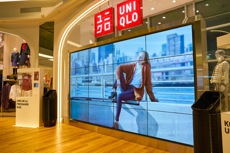 MOSCOW, RUSSIA - CIRCA SEPTEMBER, 2018: interior shot of Uniqlo store in Moscow. Uniqlo Co. Ltd is a Japanese casual wear designer, manufacturer and retailer Publikacyjne