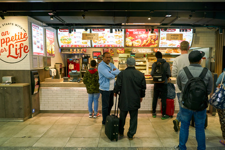 DUSSELDORF, GERMANY - CIRCA SEPTEMBER, 2018: KFC restaurant in Dusseldorf airport. KFC is an American fast food restaurant chain that specializes in fried chicken.