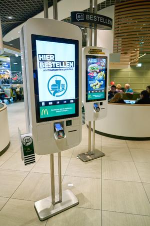 DUSSELDORF, GERMANY - CIRCA SEPTEMBER, 2018: self ordering kiosks at McDonald's restaurant in Dusseldorf airport.