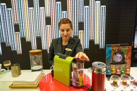 MOSCOW, RUSSIA - CIRCA SEPTEMBER, 2018: worker at a Nespresso store in Moscow, Russia. 写真素材 - 120012271
