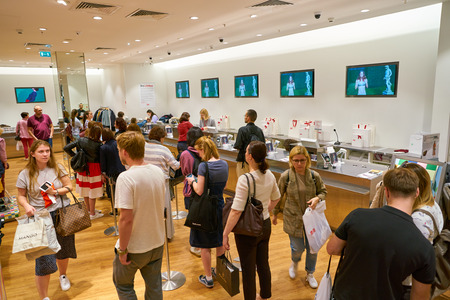 MOSCOW, RUSSIA - CIRCA SEPTEMBER, 2018: people queue at Uniqlo store in Moscow. Uniqlo Co. Ltd is a Japanese casual wear designer, manufacturer and retailer Editorial
