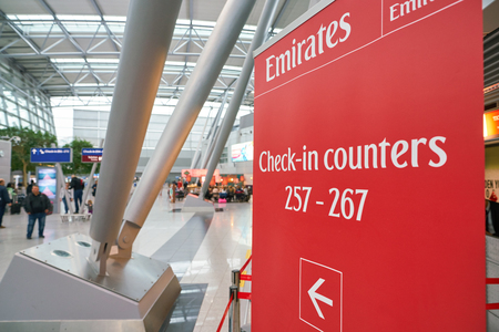 DUSSELDORF, GERMANY - CIRCA SEPTEMBER, 2018: close up shot of Emirates check-in counter sign in Dusseldorf airport. 報道画像