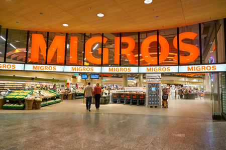 ZURICH, SWITZERLAND - CIRCA OCTOBER, 2018: entrance to Migros supermarket in Zurich International Airport. Migros is Switzerland's largest retail company.