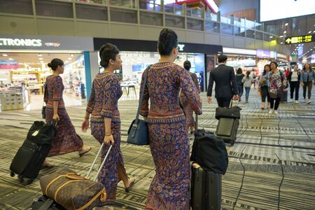 SINGAPORE - CIRCA APRIL, 2019: Singapore Airlines crew members seen at Changi International Airport.