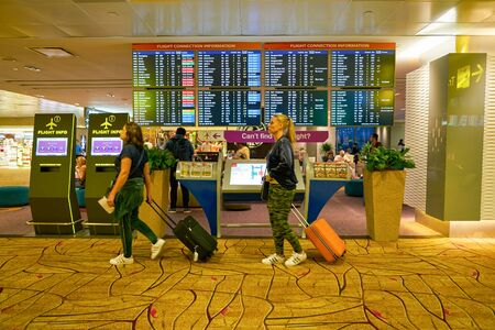 SINGAPORE - CIRCA APRIL, 2019: a flight schedule monitors at Singapore Changi International Airport. Redactioneel