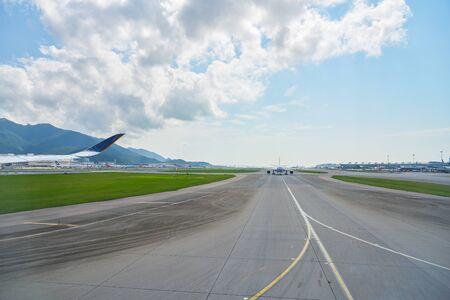HONG KONG, CHINA - CIRCA APRIL, 2019: Hong Kong International Airport seen from Singapore Airlines Airbus A350. Sajtókép