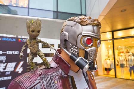 SHENZHEN, CNINA - CIRCA APRIL, 2019: close up shot of life-size Star Lord And Baby Groot statue on display in Shenzhen.