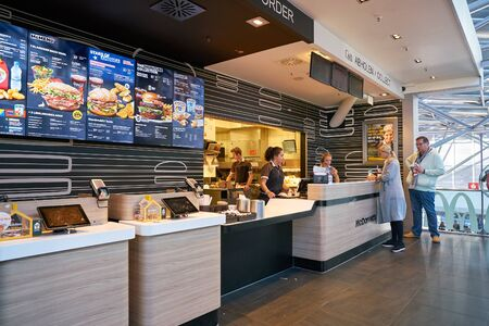 COLOGNE, GERMANY - CIRCA OCTOBER, 2018: counter service at a McDonald's restaurant in Cologne Bonn Airport.