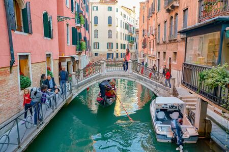 VENICE, ITALY - CIRCA MAY, 2019: view of a bridge over a narrow canal in Venice, Italy.