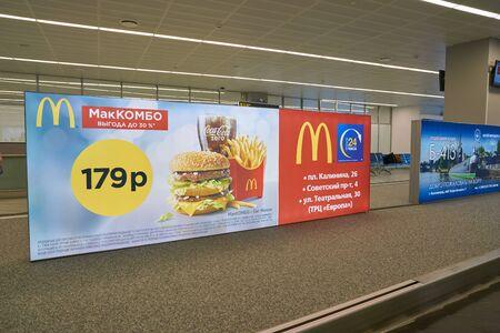 KALININGRAD, RUSSIA - CIRCA OCTOBER, 2018: McDonald's restaurant advertisement poster seen in Khrabrovo Airport. Publikacyjne