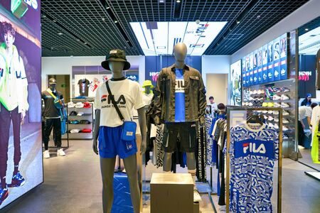 SHENZHEN, CHINA - CIRCA APRIL, 2019: clothes on display at Fila store in Shenzhen. Fila is an Italian sporting goods brand and company