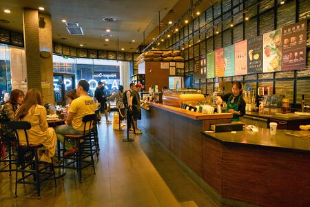 SHENZHEN, CHINA - CIRCA APRIL, 2019: interior shot of Starbucks Coffee in Shenzhen. Starbucks Corporation is an American coffee company and coffeehouse chain. Editorial