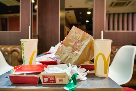 MOSCOW, RUSSIA - CIRCA JANUARY, 2019: left food tray on a table at McDonald's restaurant in Moscow.