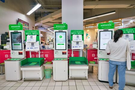 SHENZHEN, CHINA - CIRCA APRIL, 2019: self-service checkout at Carrefour Le Marche supermarket in Shenzhen.