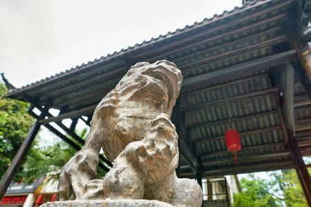 SHENZHEN, CHINA - CIRCA APRIL, 2019: statue of a Chinese guardian lion seen at Gankeng Hakka Town in Shenzhen. Gankeng Hakka Town is a tourist attraction by OCT Group. 에디토리얼