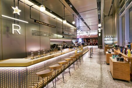 SHENZHEN, CHINA - CIRCA APRIL, 2019: interior shot of Starbucks Reserve Bar in Shenzhen. Starbucks Corporation is an American coffee company and coffeehouse chain.