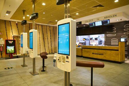 BERLIN, GERMANY - CIRCA SEPTEMBER, 2019: self ordering kiosks at McDonald's restaurant in Berlin. Redakční