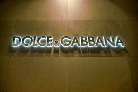 SINGAPORE - CIRCA APRIL, 2019: Dolce & Gabbana sign on a wall seen in the Shoppes at Marina Bay Sands.