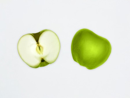 Green apples Top view Fresh granny smith Close up Two different halves of green apples are lying horizontally in a row on a white background Flat lay mockup