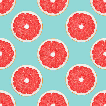 Big pink grapefruit halves on a light blue background