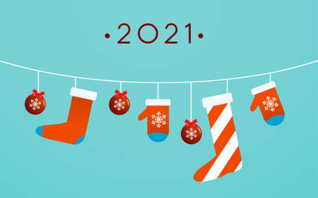 Christmas toys, stocking, and mittens are hanging on light blue background
