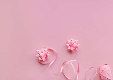 Gift wrapping Top view photo in minimal style Pink paper bows and ribbons on light pink background Photo with copy space Archivio Fotografico