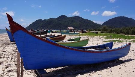 turism: Colourful fishing long boats