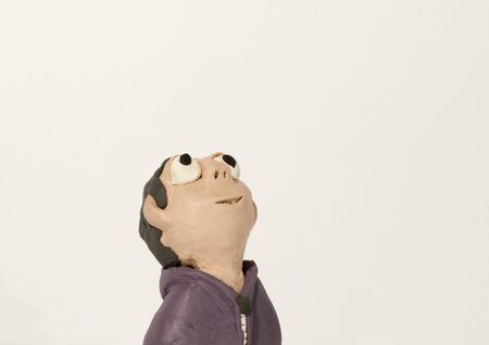 clay modeling: Plasticine character. Boy looking up
