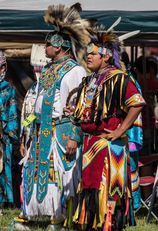 pima: Anderson, California, USA-October 2, 2015:  dancers awaits the drummers to begin the dance so she can perform at the Stillwater Pow-wow in northern California. Editorial