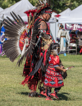 indian dance: Anderson, California, USA-October 2, 2015:  dancers awaits the drummers to begin the dance so she can perform at the Stillwater Pow-wow in northern California. Editorial