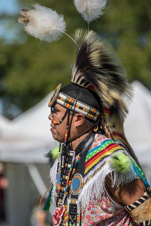 pima: Anderson, California, USA-October 2, 2015: A dancer awaits the drummers to begin the dance so she can perform at the Stillwater Pow-wow in northern California.