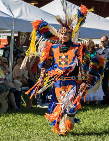 powwow: Anderson, California, USA-October 2, 2015: A dancer awaits the drummers to begin the dance so she can perform at the Stillwater Pow-wow in northern California.