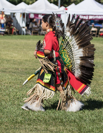 joyous festivals: Anderson, California, USA-October 2, 2015: A dancer awaits the drummers to begin the dance so she can perform at the Stillwater Pow-wow in northern California.