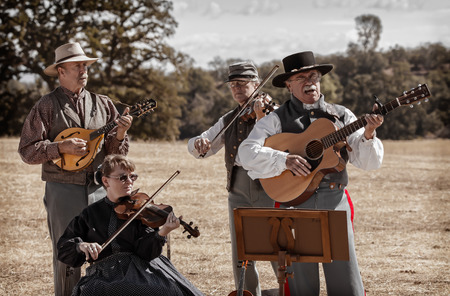 western: Confederate musicians play and sing before the next battle during a Civil War reenactment.