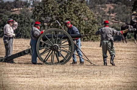 reenactment: Cannon Crew, Civil War Reenactment at Anderson, California. Editorial
