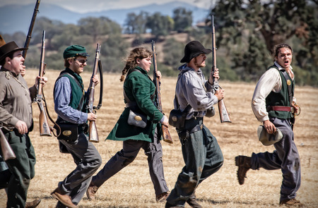 troops: Confederate troops march towards the Union Army during a Civil War reenactment in Anderson, California.