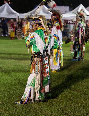 powwow: Anderson, California, USA-October 3, 2015:  Native American dancers perform a dance to the drums at the Stillwater Pow-wow in northern California.