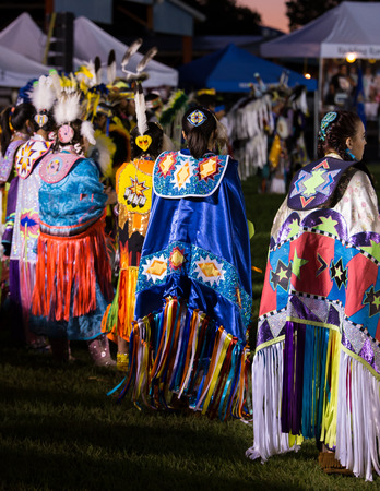 powwow: Anderson, California, USA-October 3, 2015:Native American dancers perform a dance to the drums at the Stillwater Pow-wow in northern California.