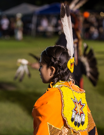 powwow: Anderson, California, USA-October 3, 2015: A Native American dancer performs a dance to the drums at the Stillwater Pow-wow in northern California.