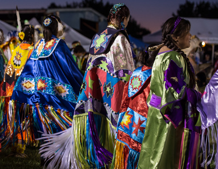 pima: Anderson, California, USA-October 3, 2015:  Native American dancers perform a dance to the drums at the Stillwater Pow-wow in northern California.