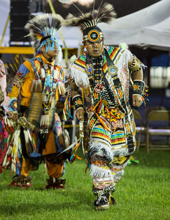 pima: Anderson, California, USA-October 3, 2015: A Native American dancer performs a dance to the drums at the Stillwater Pow-wow in northern California.