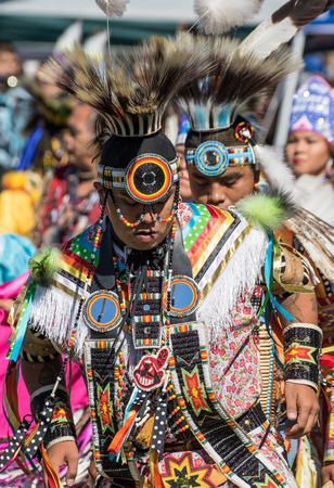 joyous festivals: Anderson, California, USA-October 3, 2015: A Native American dancer performs a dance to the drums at the Stillwater Pow-wow in northern California.