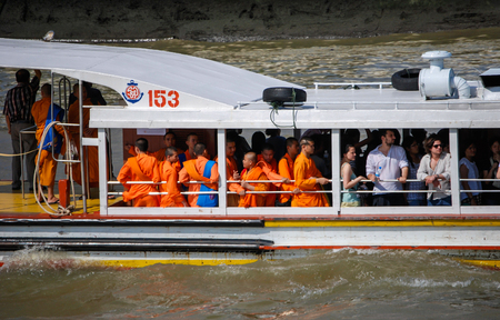 chao phraya river: Monks on a water Taxi on the Chao Phraya River, Bangkok.
