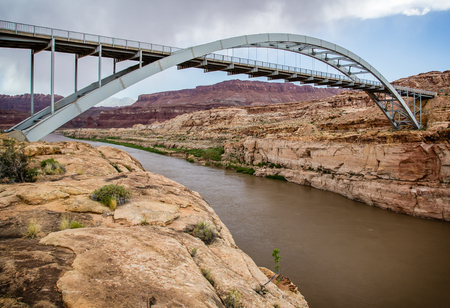 95: A large metal bridge over the Colorado River on highway 95 at Hite Crossing, Utah. Stock Photo