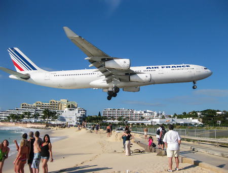 juliana: Airliner over Maho Beach, St. Maarten.